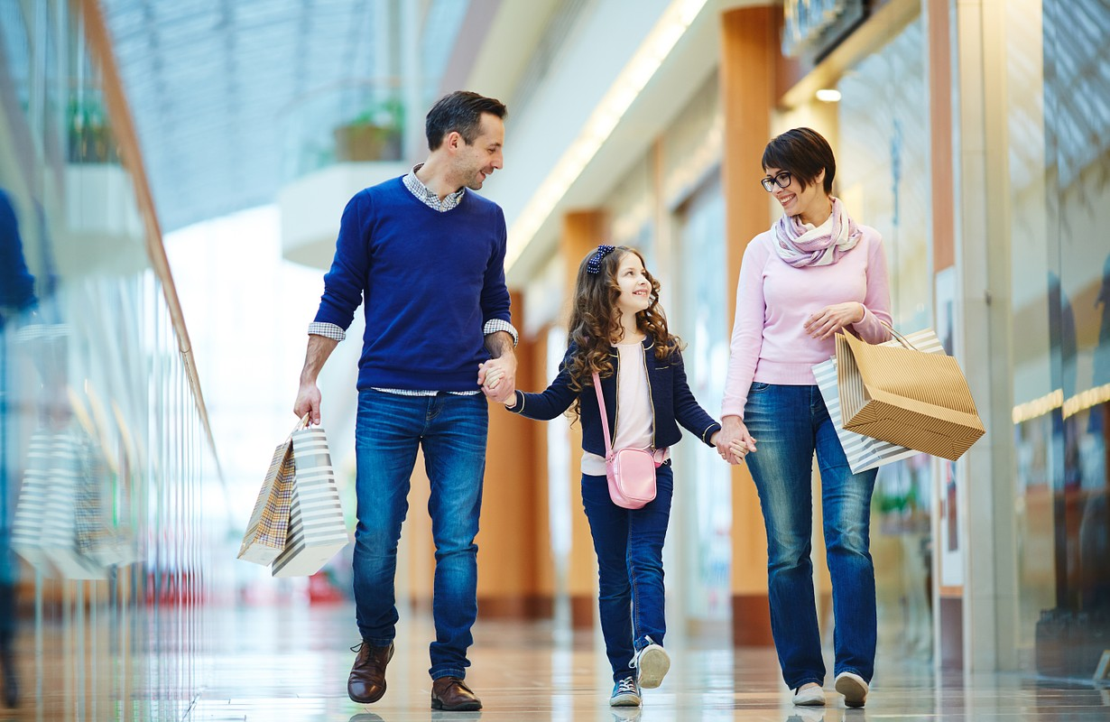 family happy in shopping mall