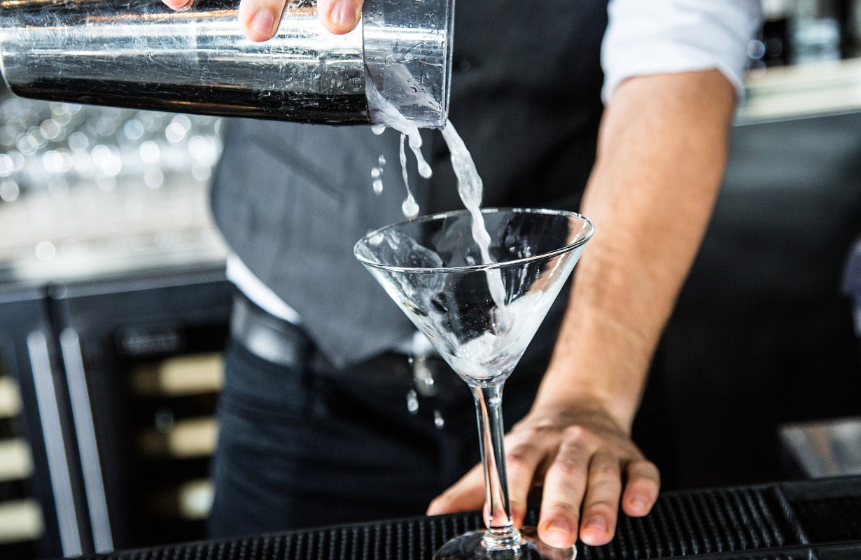 serving cocktail