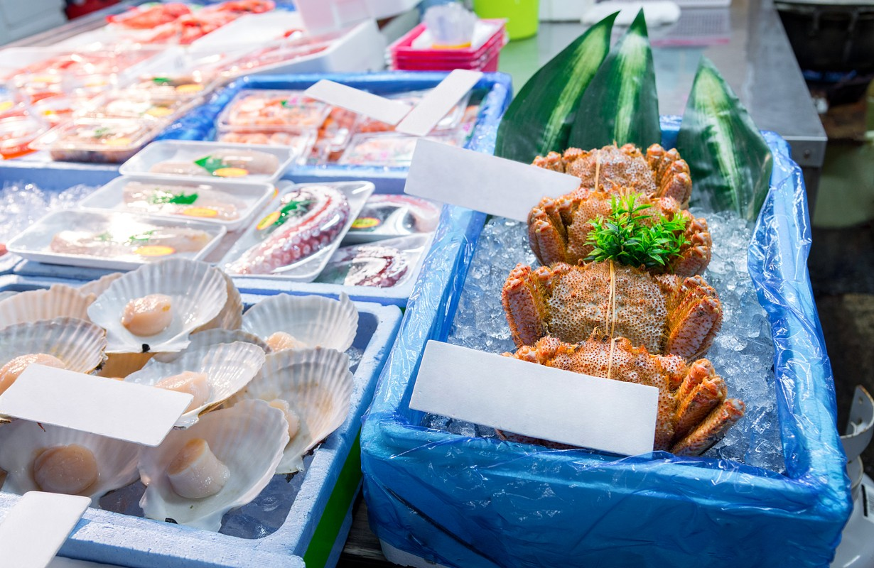 Shoppers visit Stalls selling fish in the tsukiji fish market is the biggest wholesale fish and seafood product market in the world, fresh seafood product