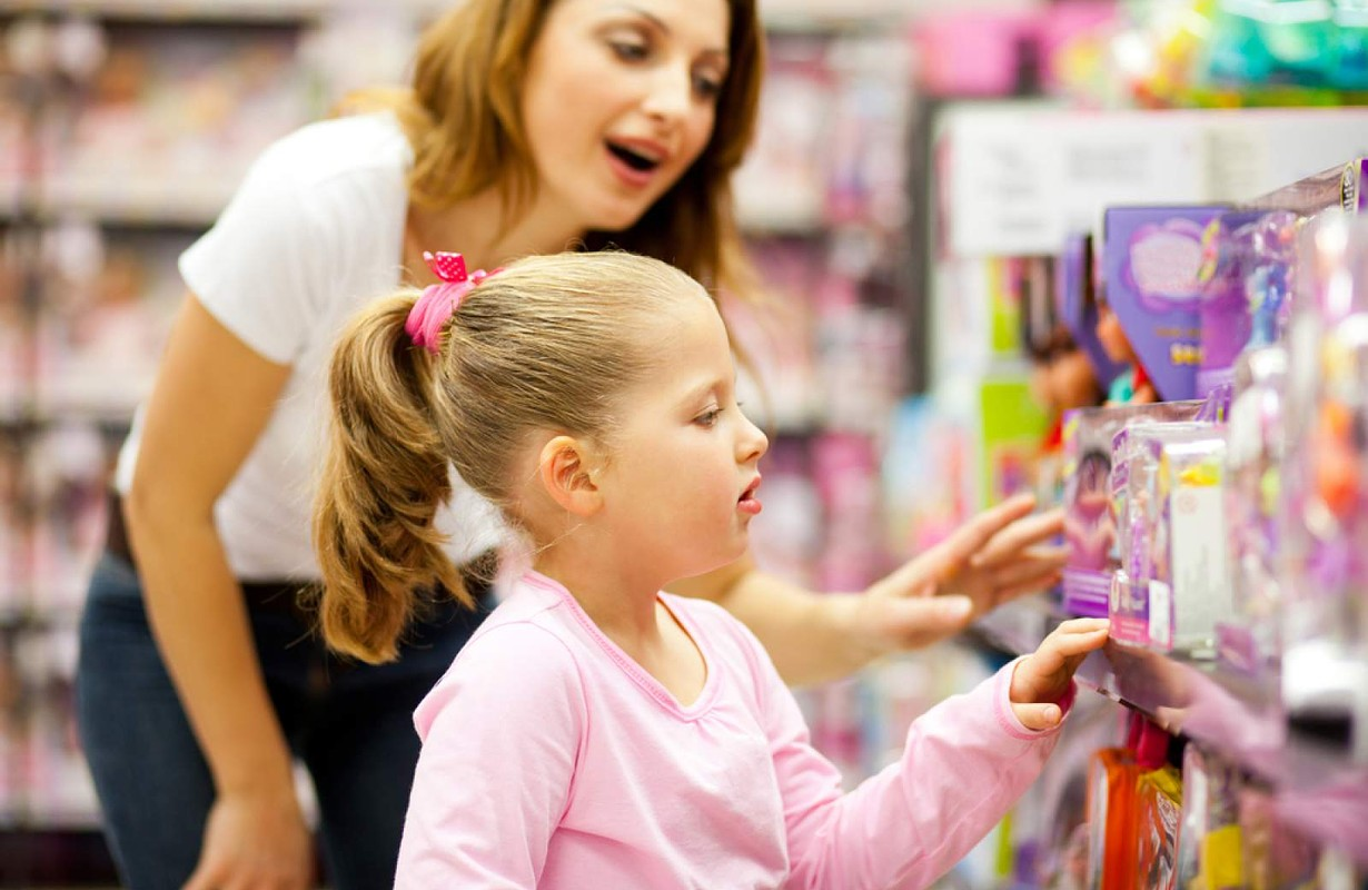 Girl with mother in a store