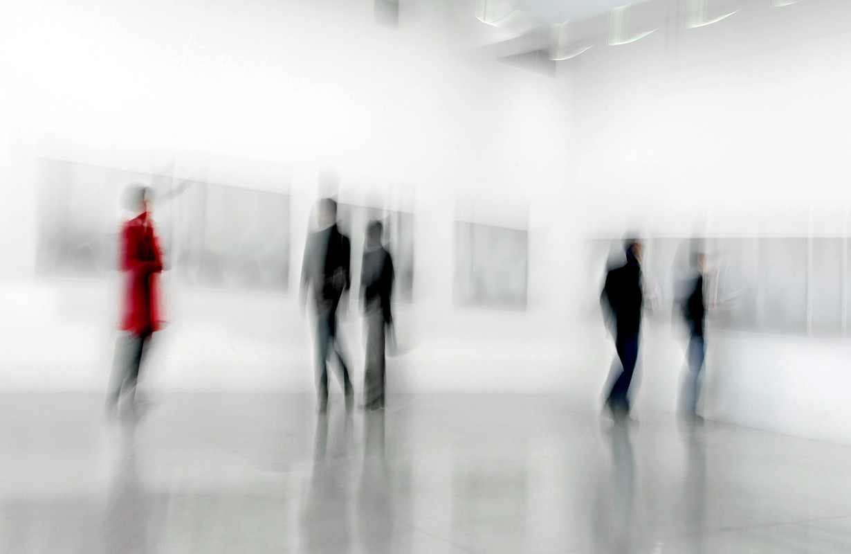 abstract image of people in the lobby of a modern art center