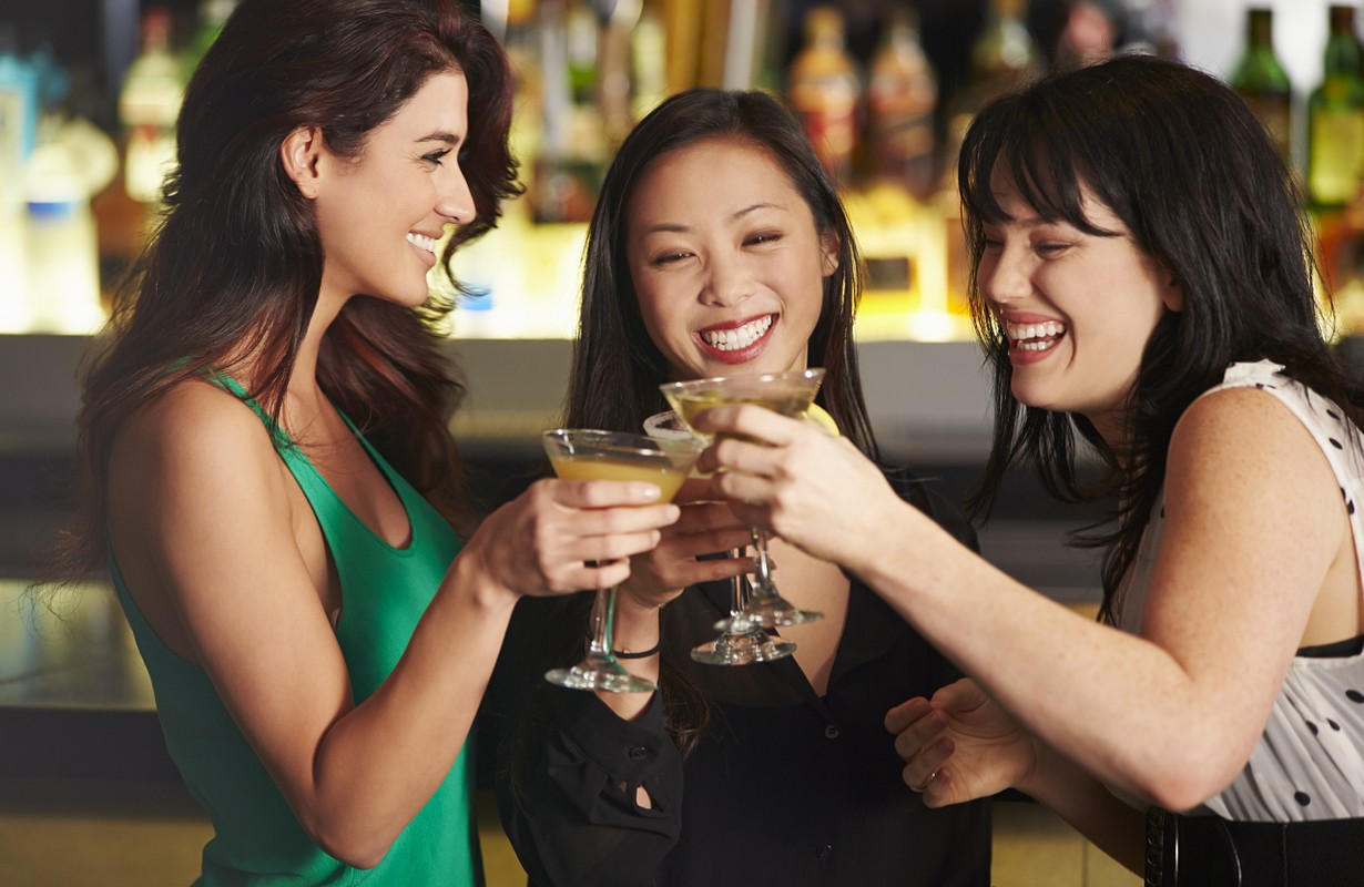 Three Female Friends Enjoying Drinks In Cocktail Bar - Los Angeles, California