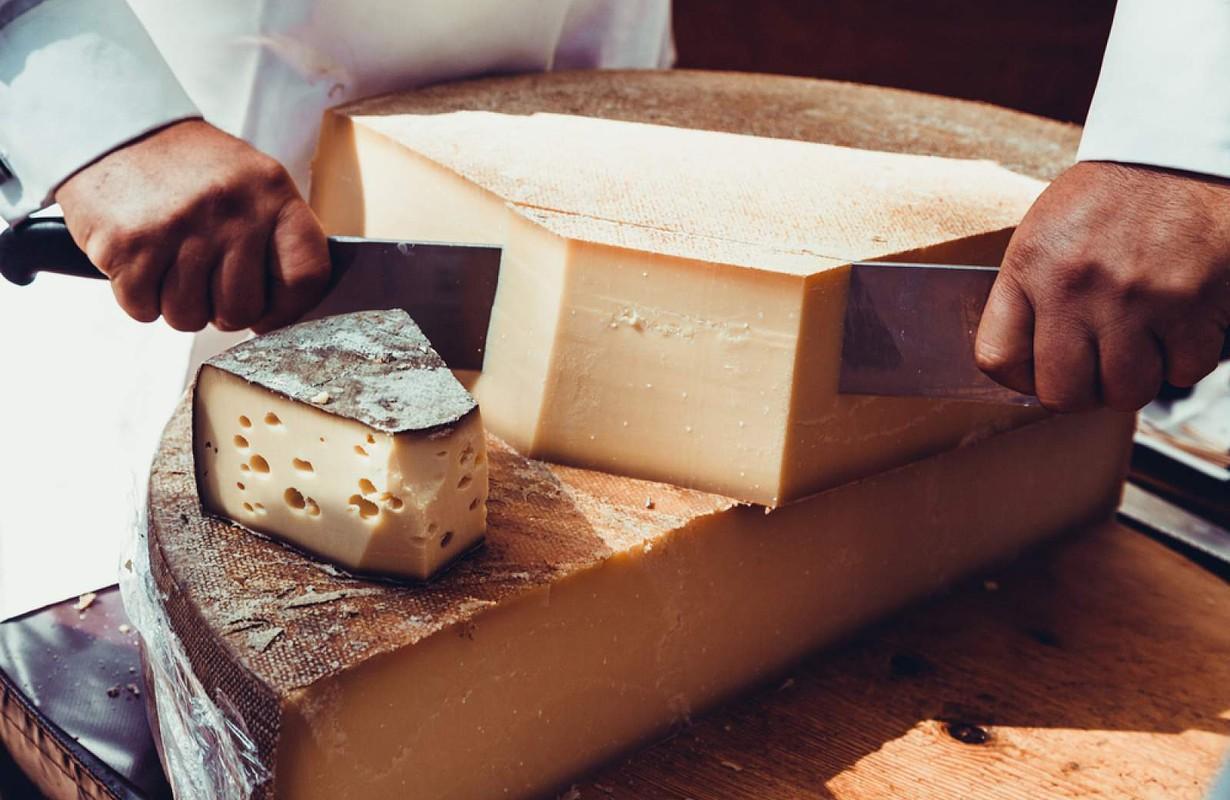 Man cutting cheese