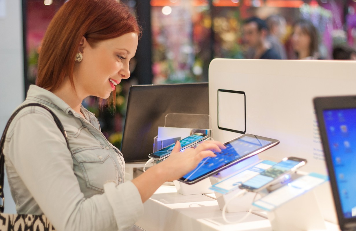 Woman buying a tablet