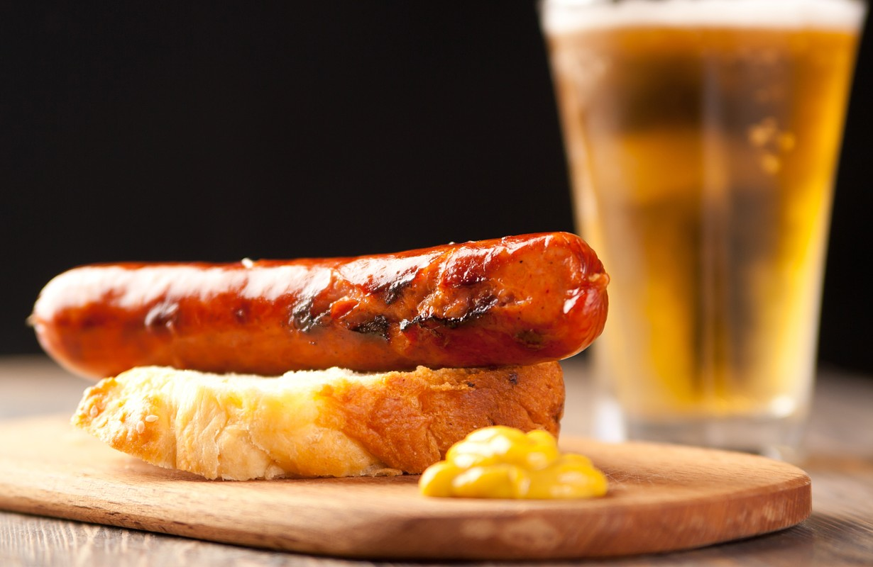Bratwurst sausage with beer and mustard