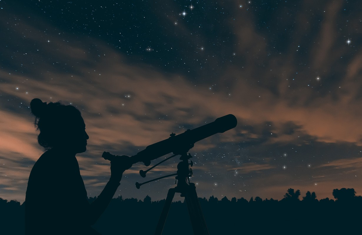 Woman with telescope.