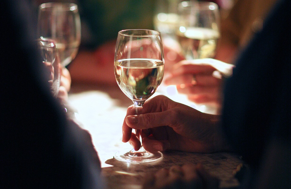 Hands holding wine glasses