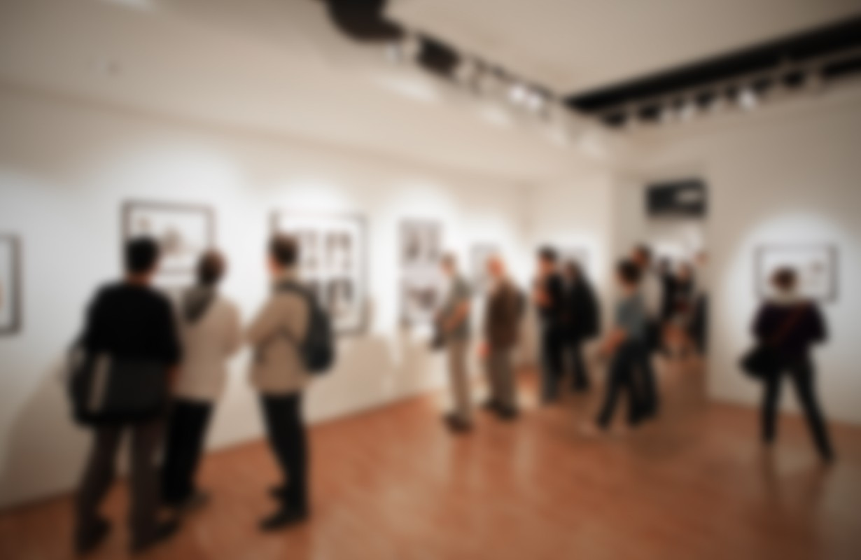 Photography gallery, people background. Intentionally blurred editing post production. Location, works and people not recognizable.