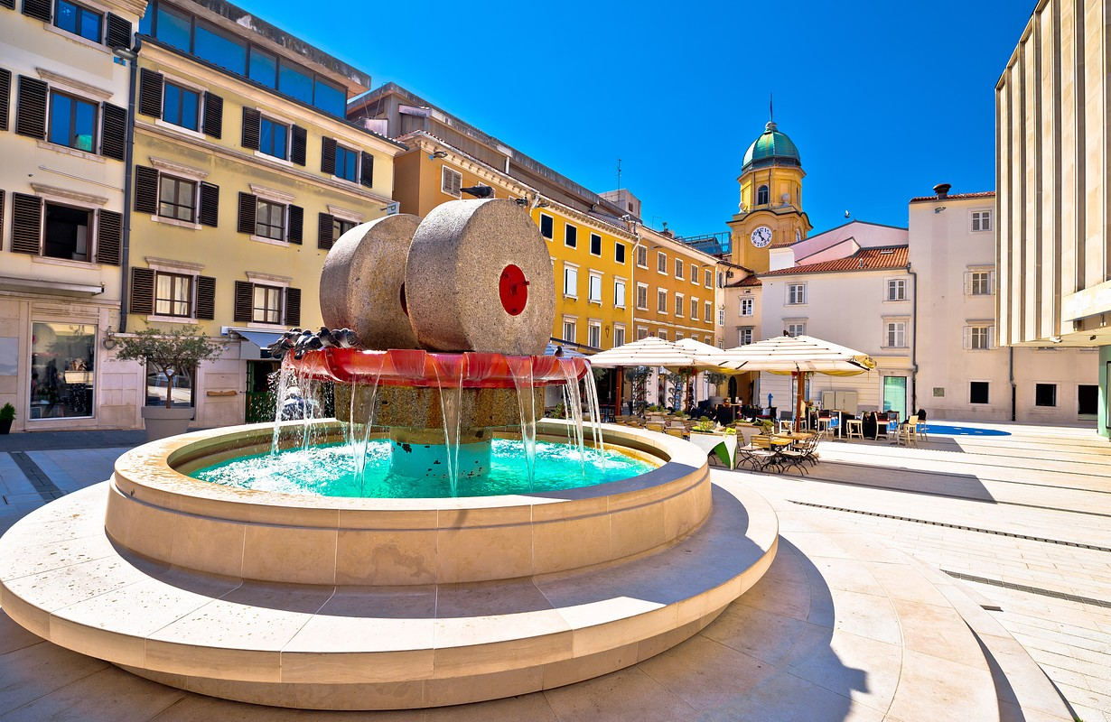 Rijeka square and fountain view with clock tower gate, Kvarner, Croatia