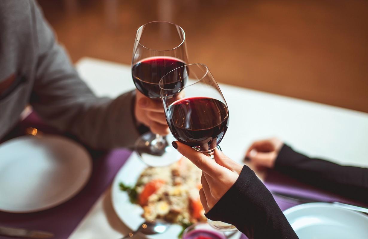 Couple having wine and dinner at Fru Larsen in Randers, Denmark
