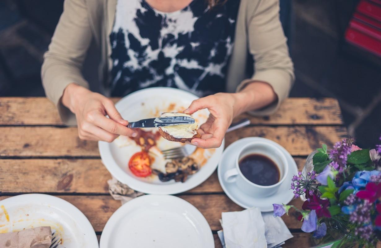 Woman having breakfast at Café Blicher in Randers, Denmark