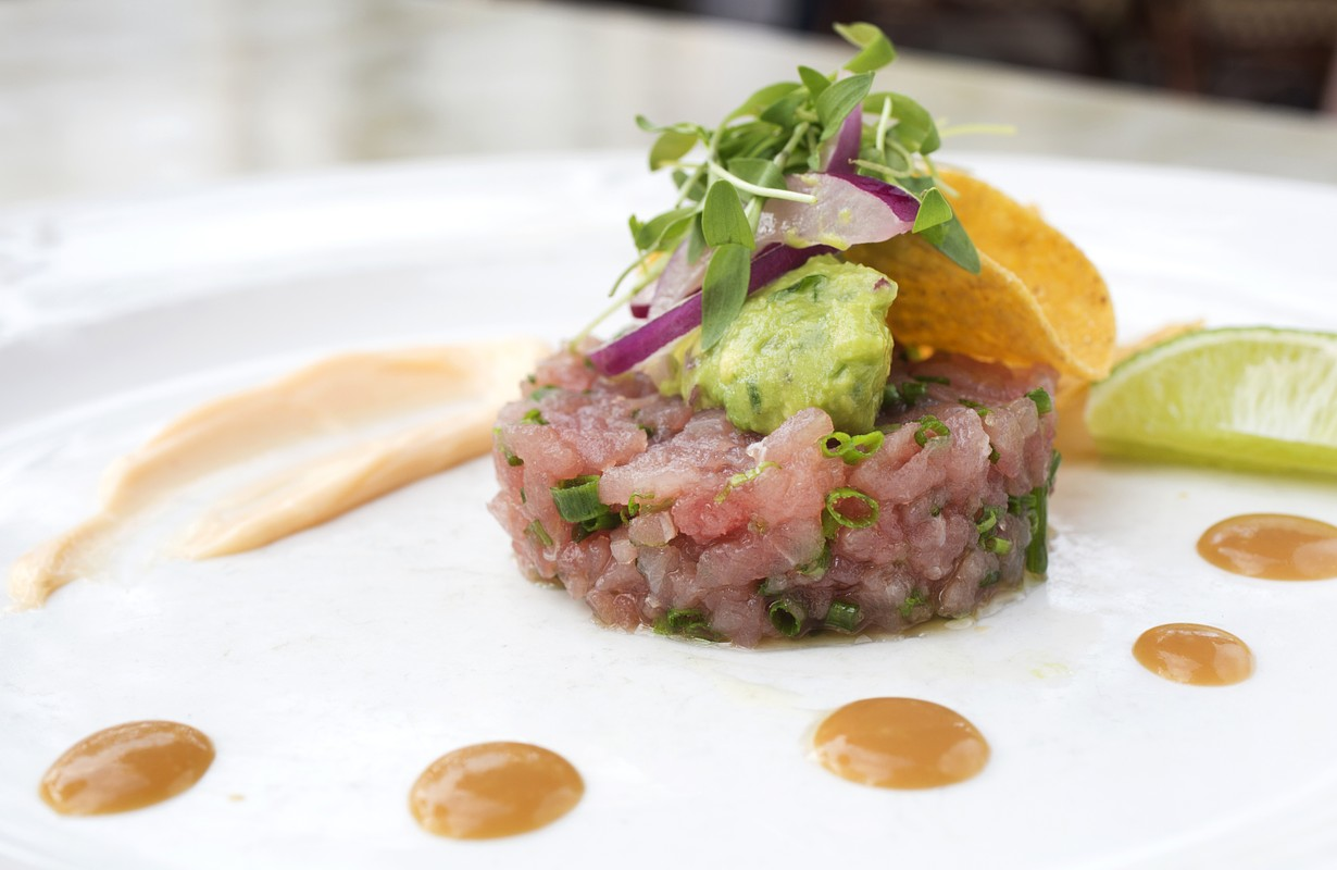 Tuna tartare taco with ginger soy dressing, avocado and pickled red onion