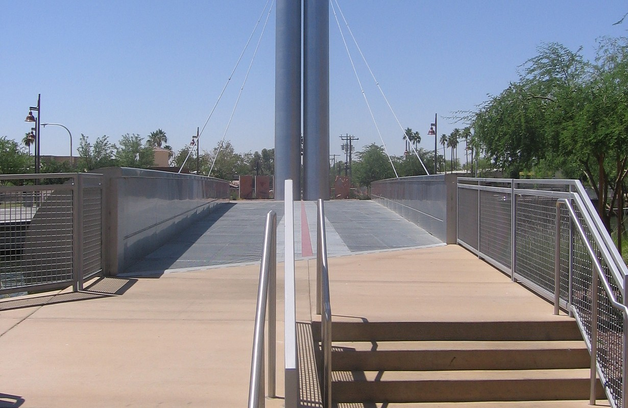 Pedestrian bridge over the Arizona Canal in Scottsdale, Arizona, USA near the intersection of North Scottsdale Road and East Camelback Road. The bridge was designed by architect Paolo Soleri. This view is looking south.