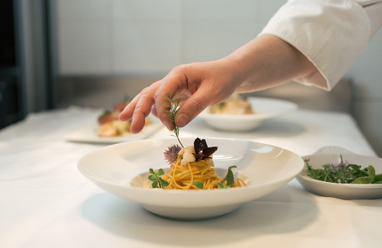 Chef preparing food at fine dining restaurant