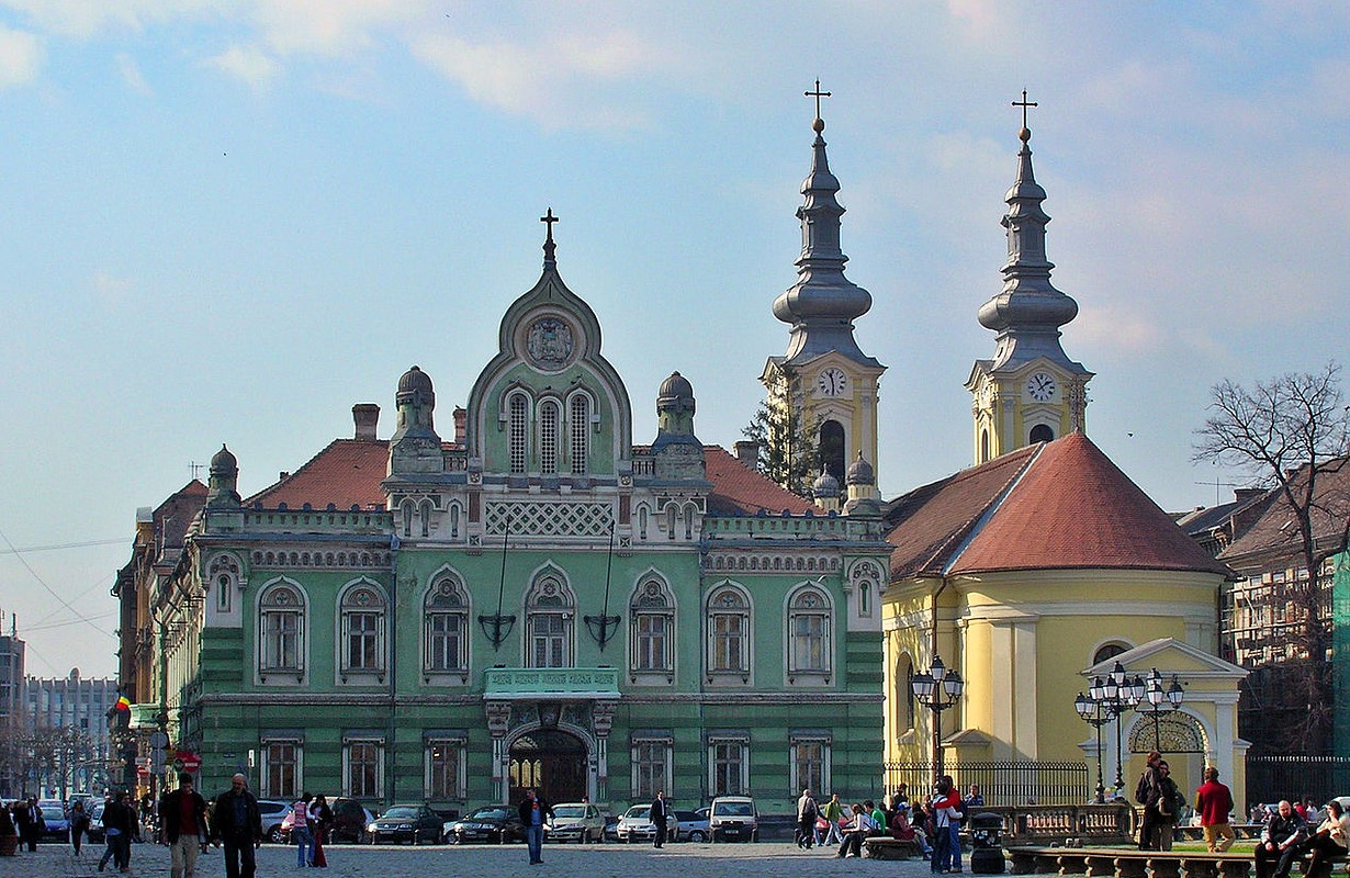 Piaţa Unirii. On the left - Serbian bishops palace, on the right - Serbian orthodox Cathedral. Timişoara (Romania).