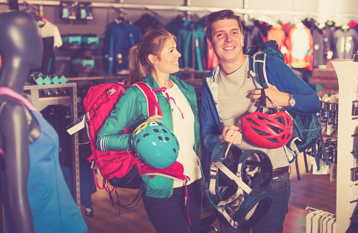 Couple buying sports equipment in a shop