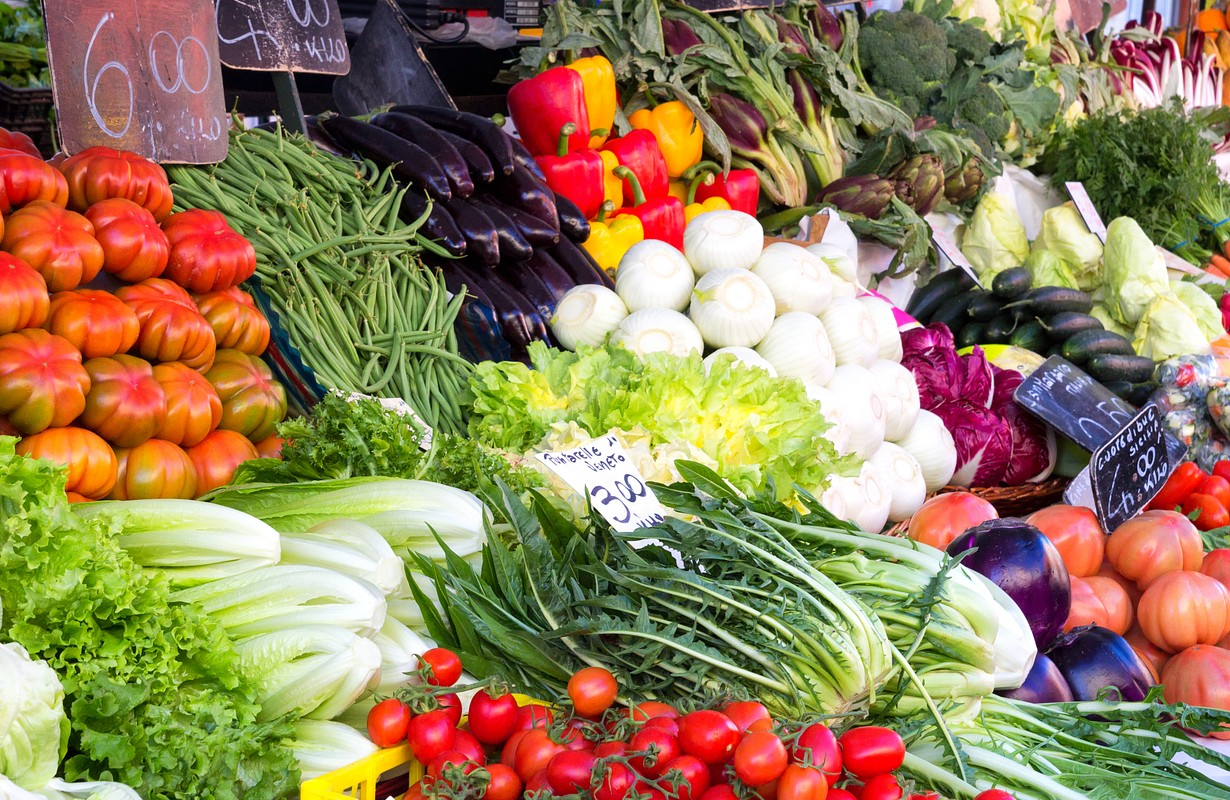 Colourful fresh fruit and vegetables stall arrangement