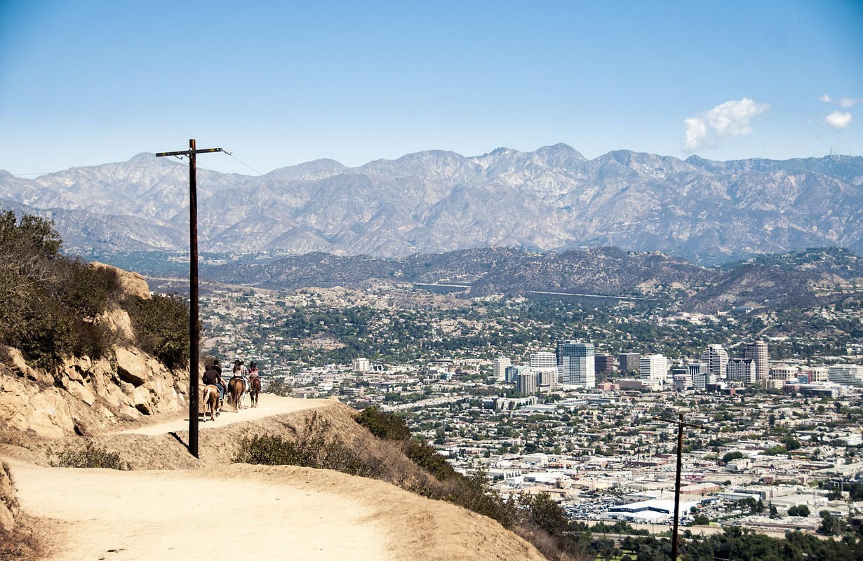 Horseback riding on a trail in Griffith park, Los Angeles, California