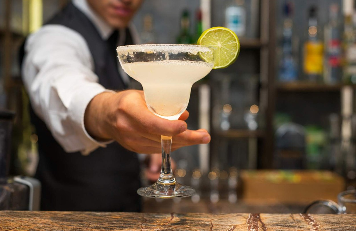 Cocktail served by barman