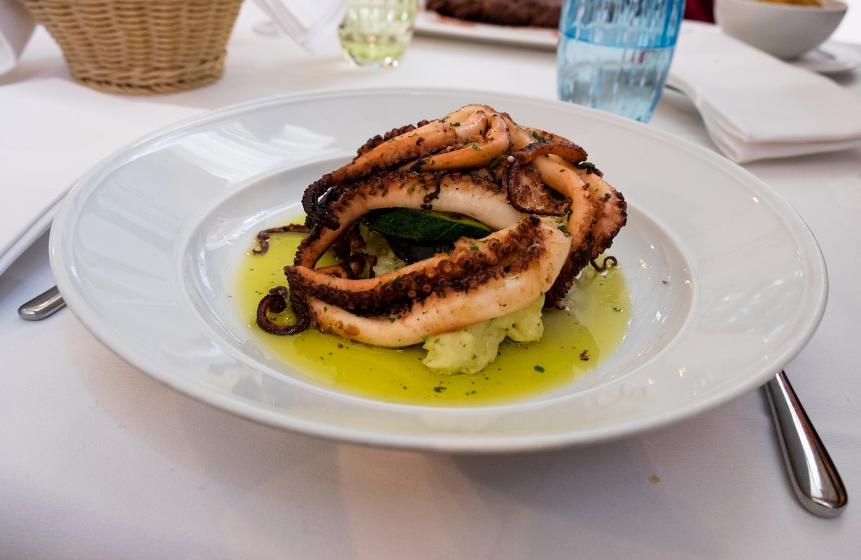 Freshly caught octopus grilled with garlic and olive oil and served with wine sauce