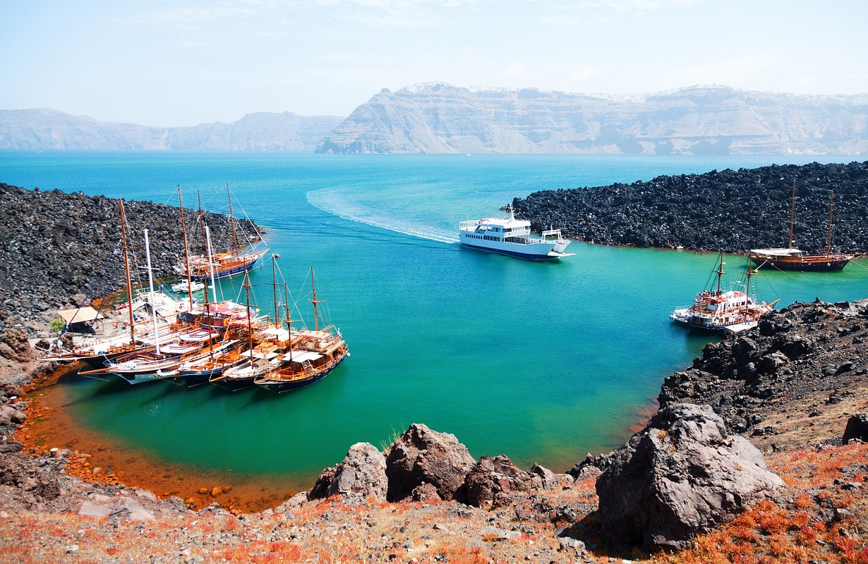 There are volcano cruises and short trips from Fira with a boat and a lot of tourists visit the volcanic landscape