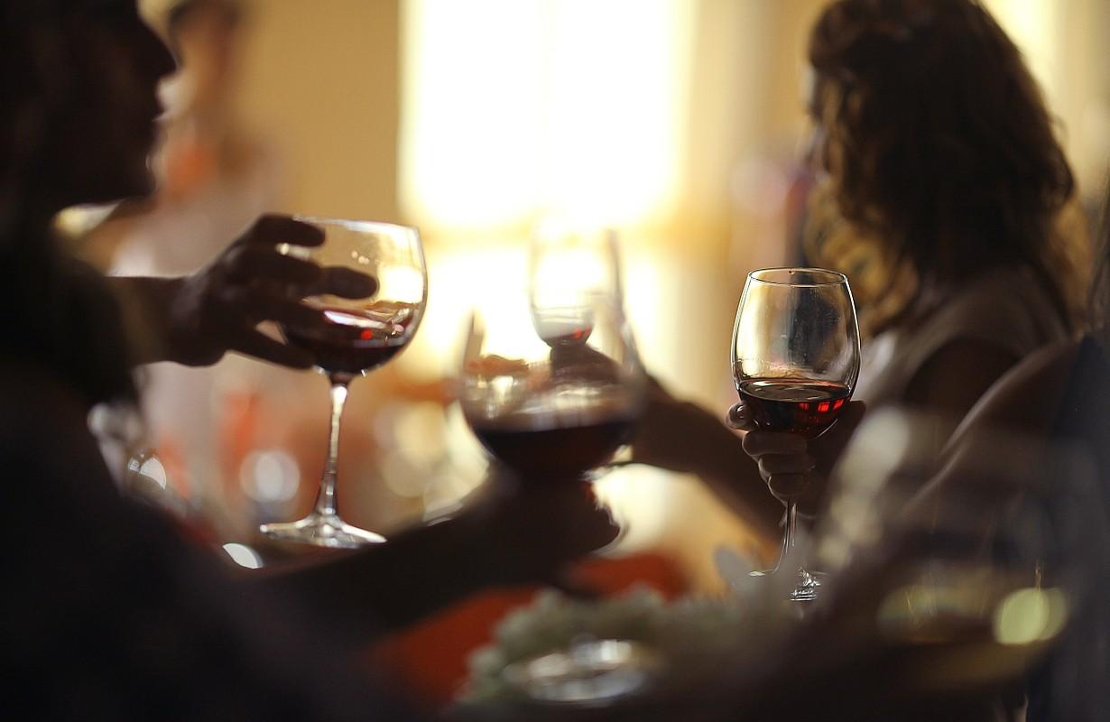 People drinking wine in bar