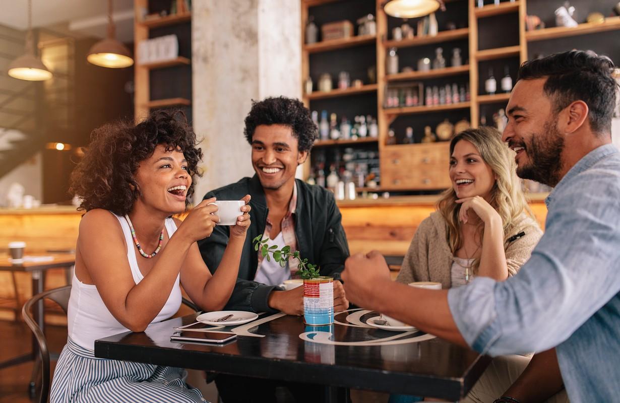 Friends having a coffee at Café K in Randers, Denmark