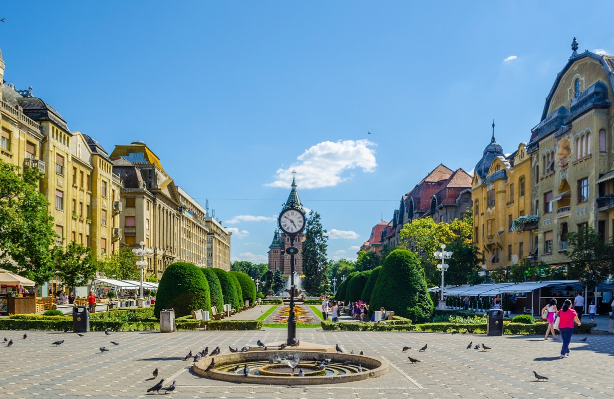 Victory square - piata victoriei - timisoara is a long square with green park surrounded by national opera on one side and the metropolitan cathedral on the other.