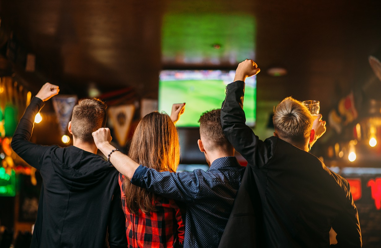 Friends watching sports at a sports bar