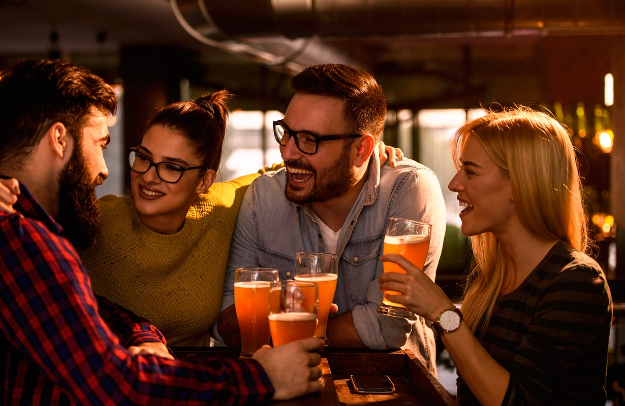 Friends laughing at a bar - Atlanta, Georgia