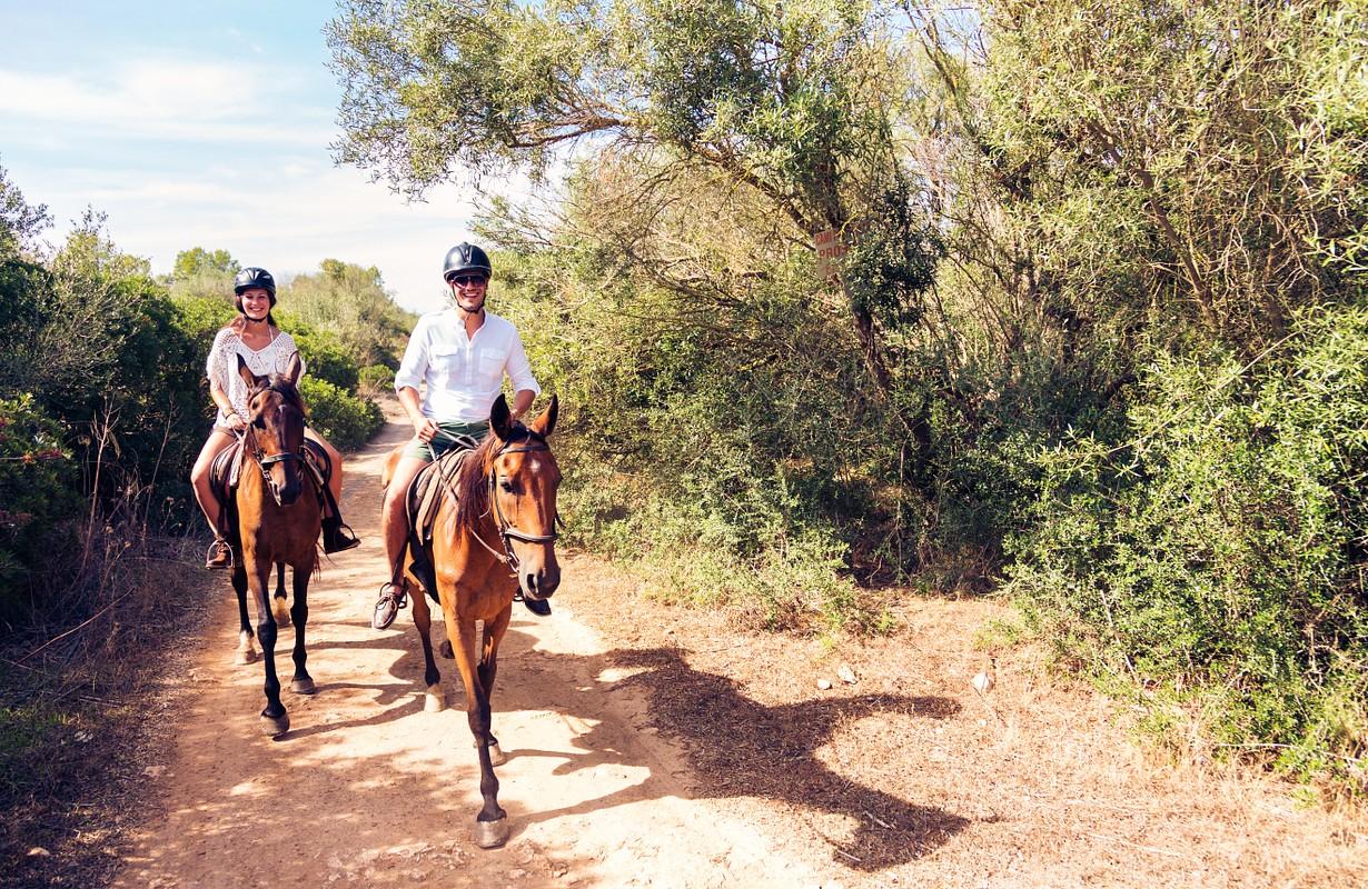 Couple horse riding