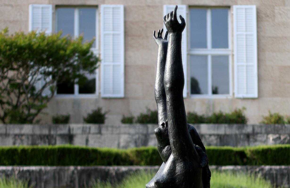 Sculpture by famous Croatian artist Ivan Meštrovi? in front of his museum in Split, Croatia. Vertical format, selective focus.