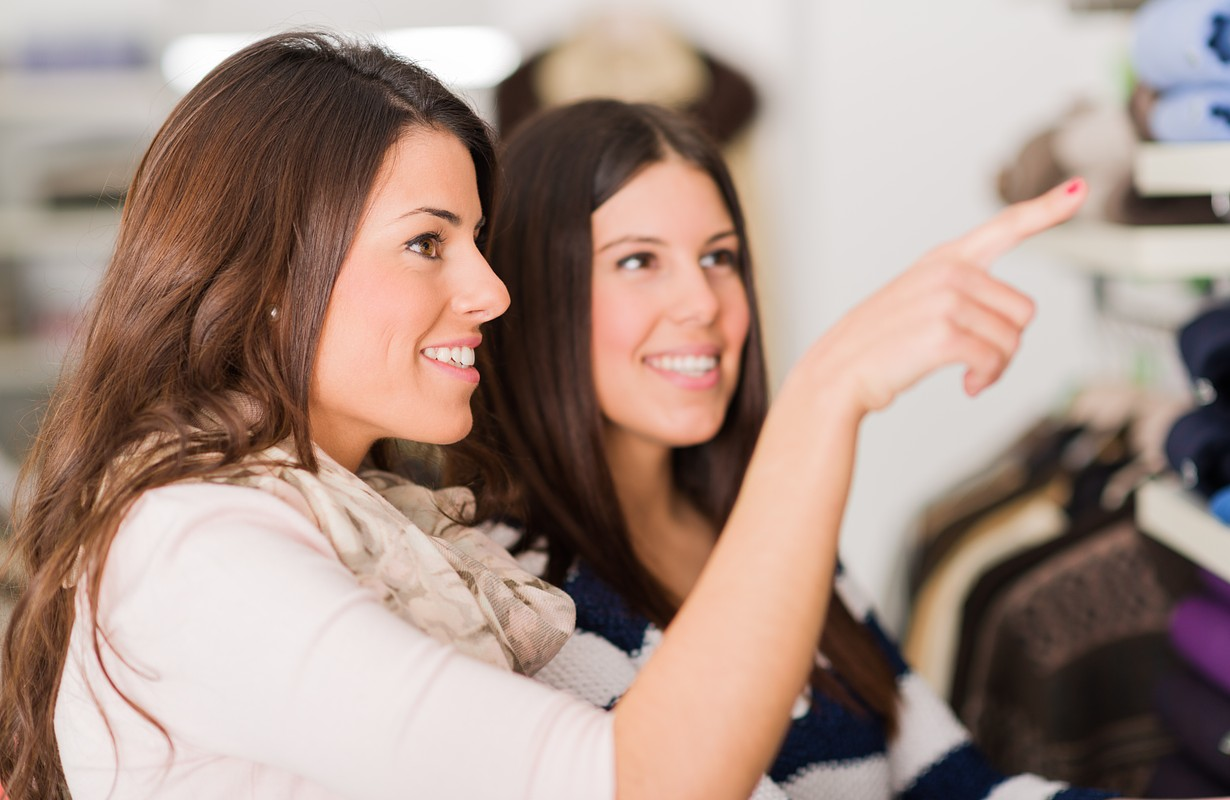 Two Happy Young Women Shopping In Mall, Indoors