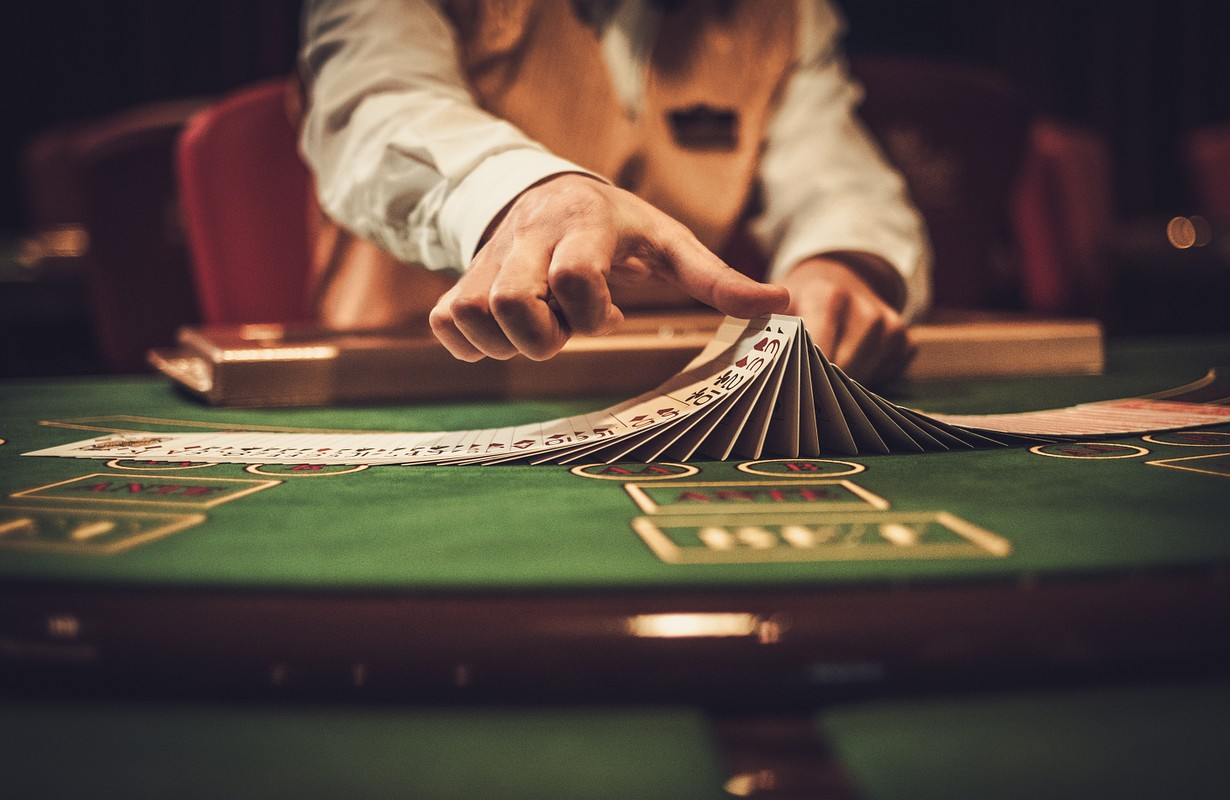 Croupier behind gambling table