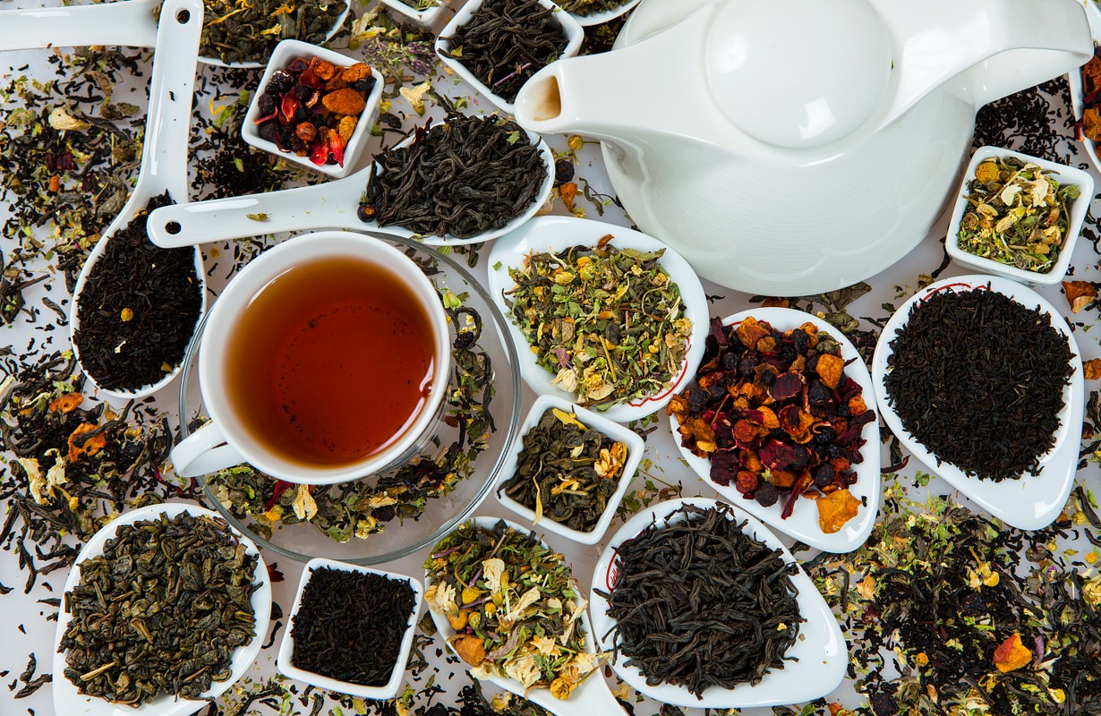 Assortment of dry tea. Various kinds of tea isolated on white.Different kinds of tea leaves. Tea composition with different kind of tea. Tea concept. Tea leaves