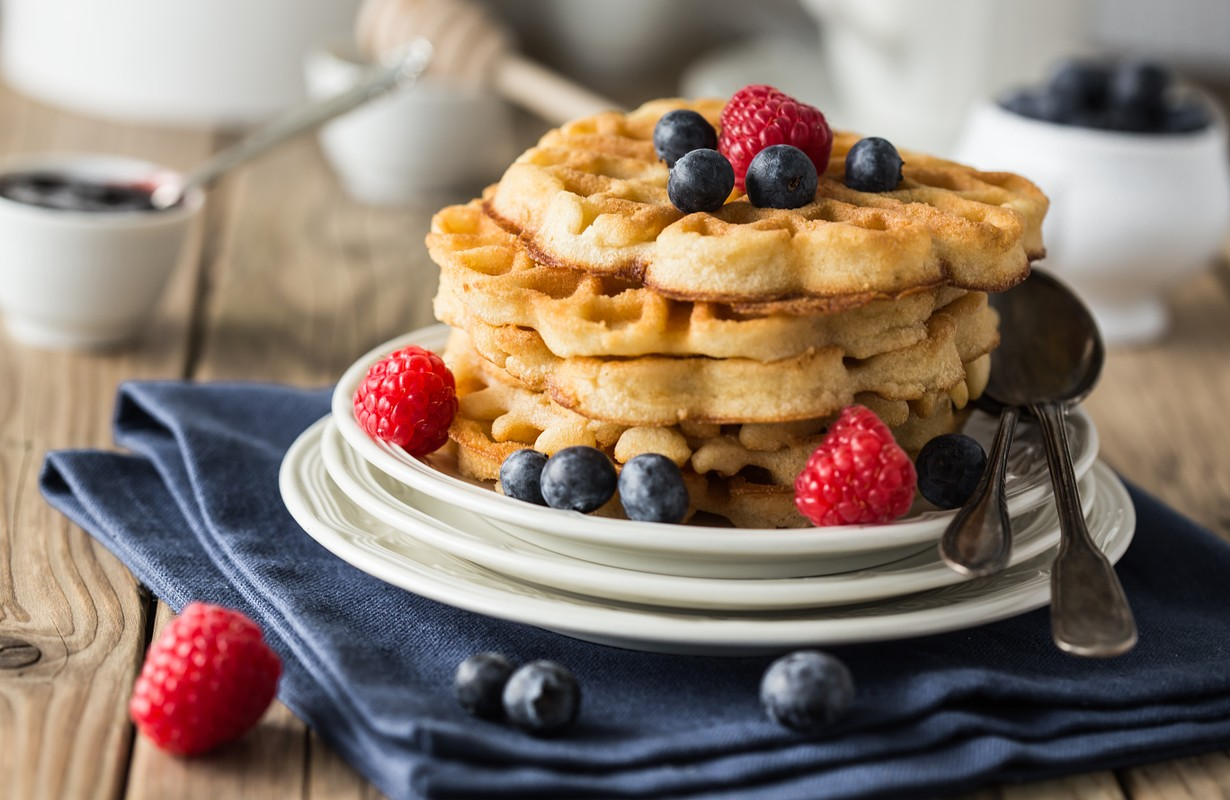 Blueberry waffles with raspberries for breakfast
