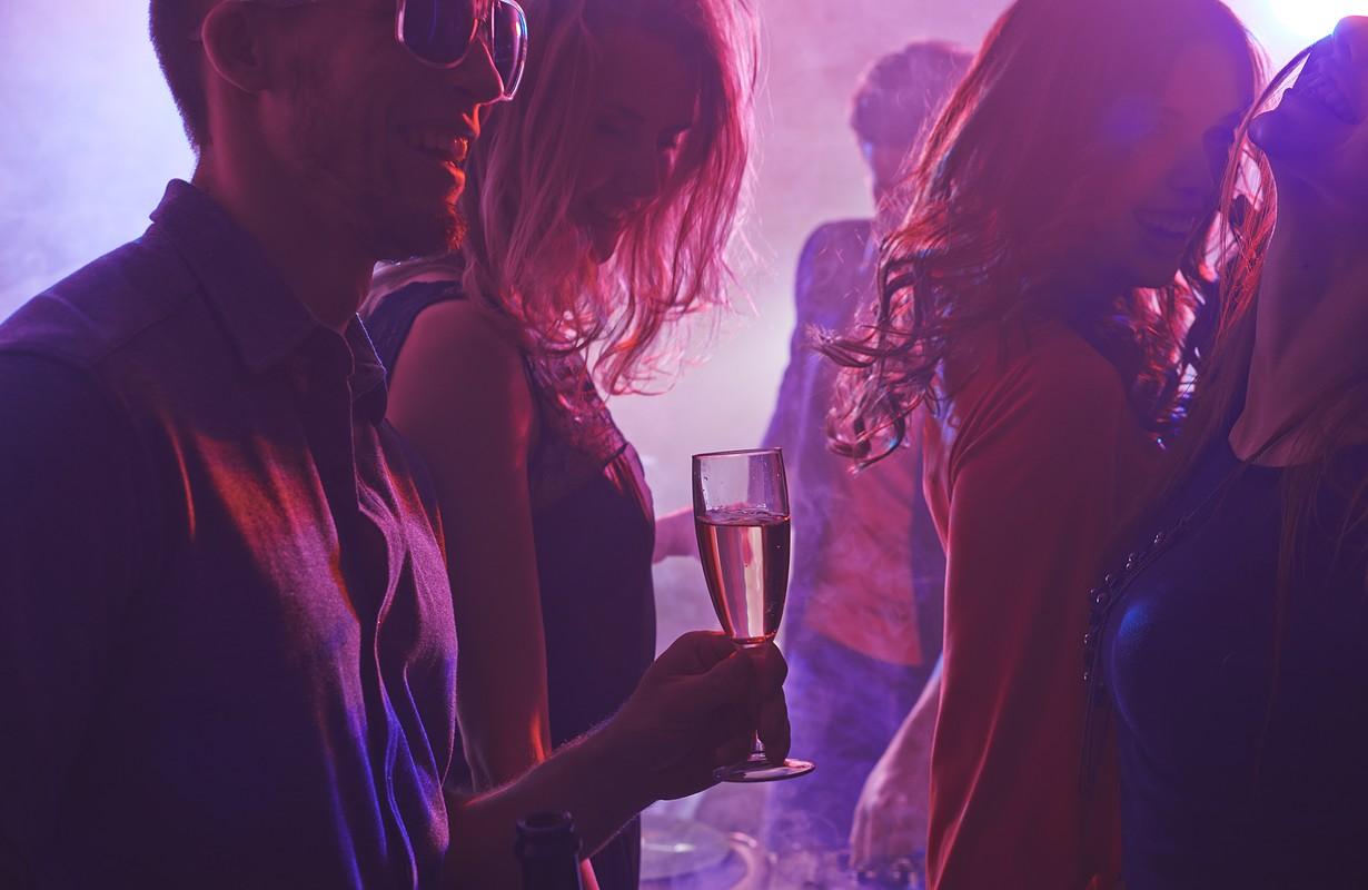 Cheerful friends enjoying party in nightclub