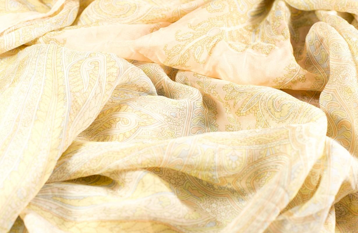 silk shawls peach color as a background