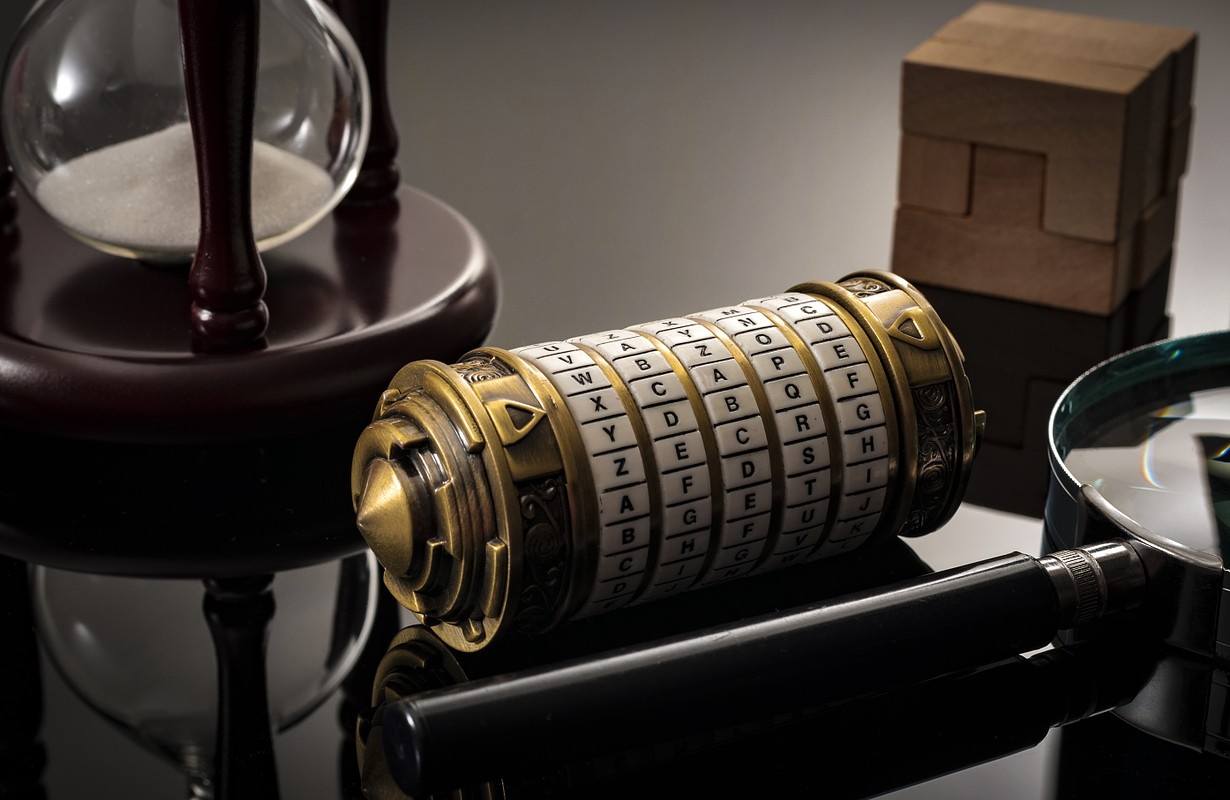 Escape the room or escape game, is a physical game where players are locked in a room and a required to examine clues and solve a puzzles. The word Xcape? is the password for this cryptex riddle