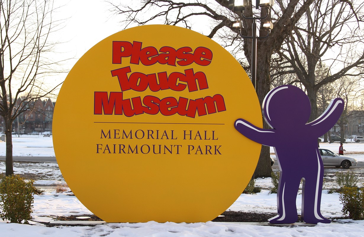 Please touch museum sign