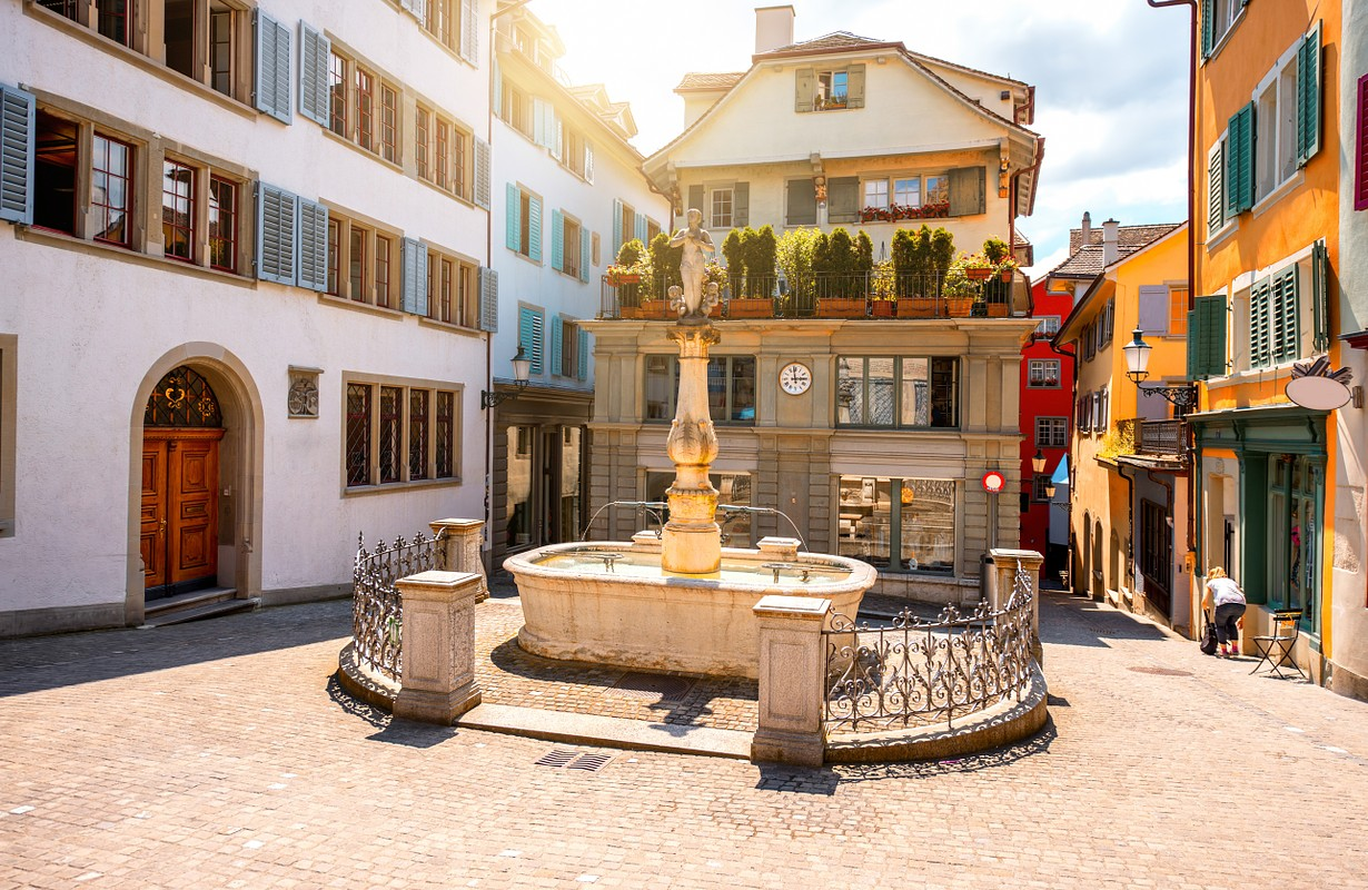 Beautiful small square with fountain in the old town of Zurich