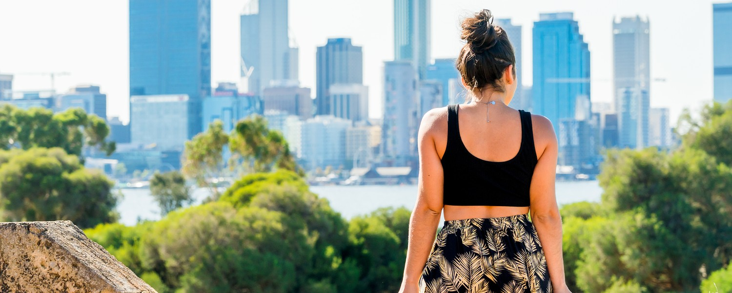 Woman overlooking the Perth skyline