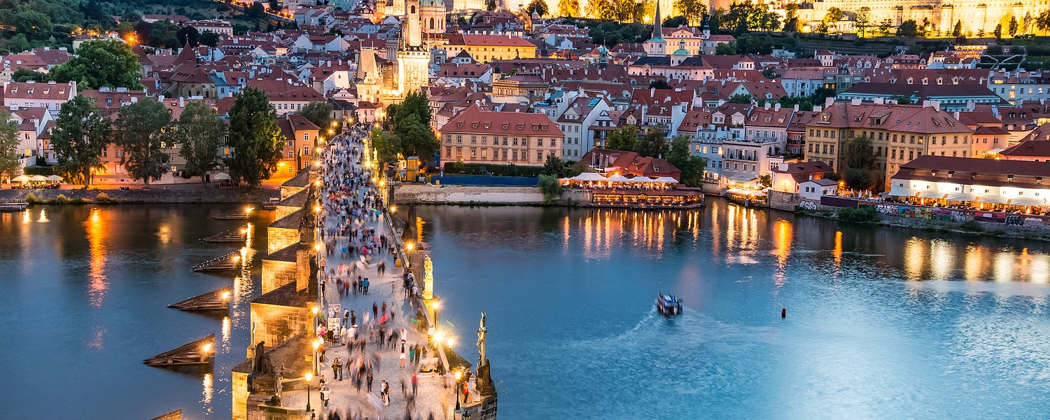 panorama of Prague with red roofs from above summer day at dusk, Czech Republic