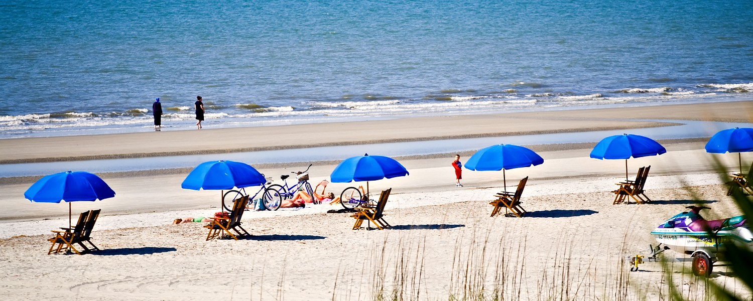 Hilton Head Island, South Carolina beach landscape - rental umbrellas, bikes and chairs.