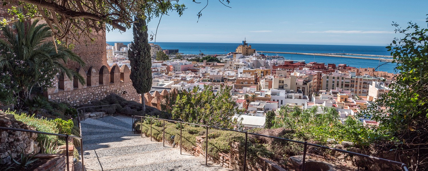 Medieval moorish fortress Alcazaba in Almeria, Access to the fortress with gardens and trees of different species, panoramic view of the city, take in Almeria, Andalusia, Spain