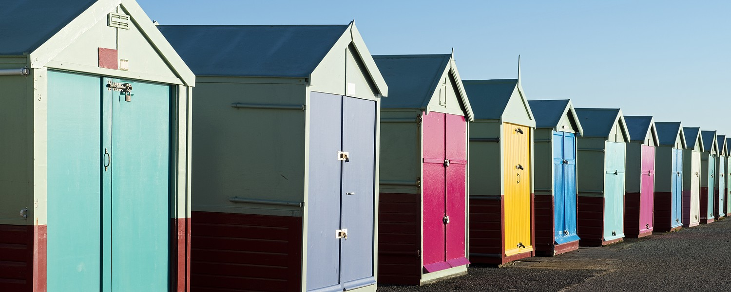 Colorful Beach Huts at Hove, near Brighton, East Sussex, UK.