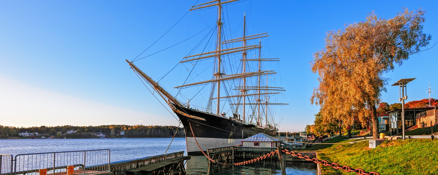 Sunset autumn view to four-masted sailing vessel in Mariehamn as a museum ship at Aland Islands, Finland