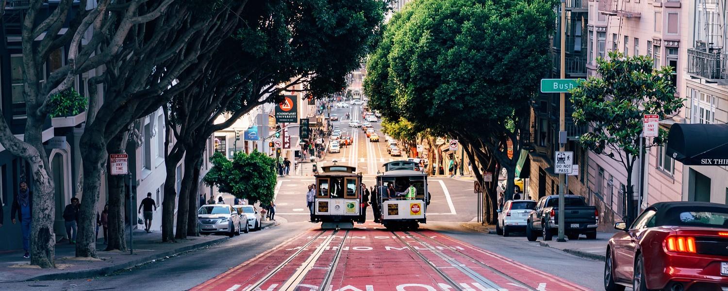 cablecars moving down the street of San Francisco, California