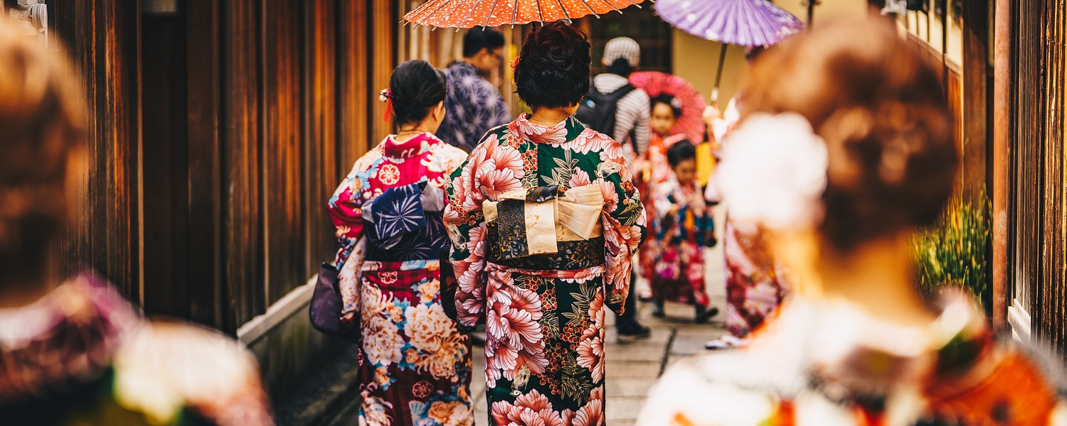 Women in traditional japanese kimonos walking in Kyoto