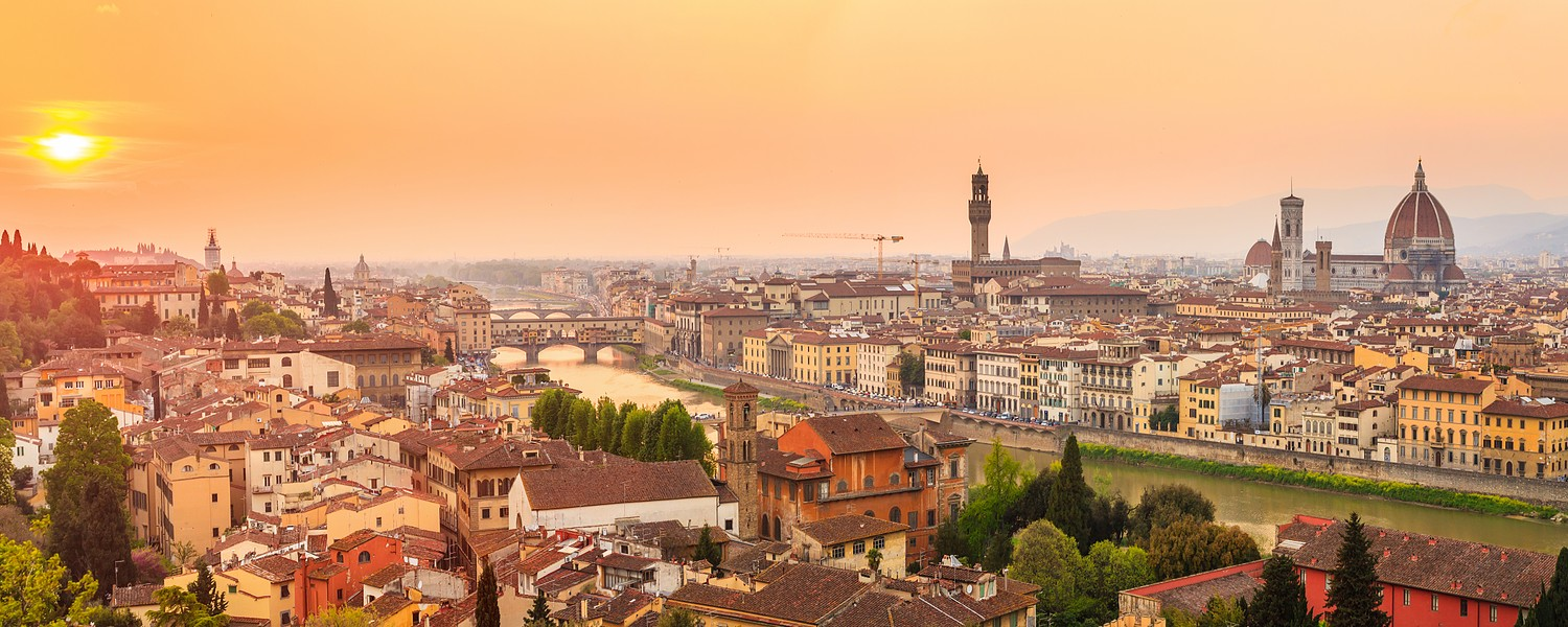 Florence city during sunset. Panoramic view to the river Arno, with Ponte Vecchio, Palazzo Vecchio and Cathedral of Santa Maria del Fiore (Duomo), Florence, Italy